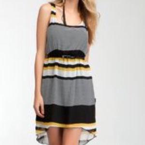 Bebe black white yellow stripes high low dress L